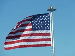 picture of American flag on flagpole with solar light